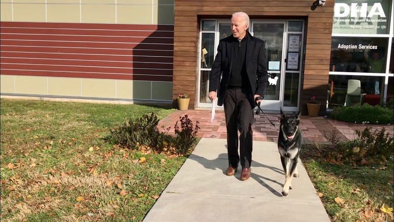 Joe Biden leaves Delaware Humane Association with adopted dog Major in 2018.