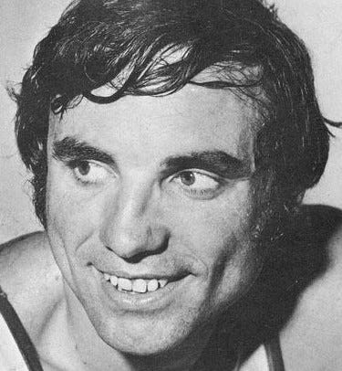 Dave DeBusschere smiles in an up-close headshot.