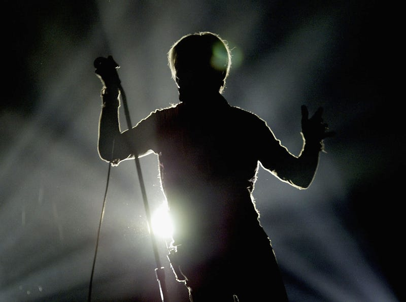 David Bowie in silhouette performs on the first night of his UK tour at the MEN Arena on November 17, 2003 in Manchester, England.