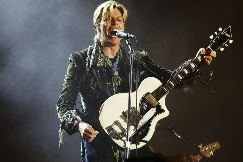 """David Bowie performs on stage on the third and final day of """"The Nokia Isle of Wight Festival 2004"""" at Seaclose Park, on June 13, 2004 in Newport, UK. The third annual rock festival takes place during the Isle of Wight Festival which runs from June 4-19."""