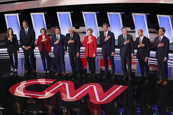 The Democratic candidates are pictured during the national anthem.