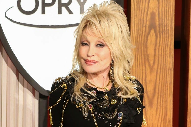 Dolly Parton attends a press conference before a performance celebrating her 50-year anniversary with the Grand Ole Opry
