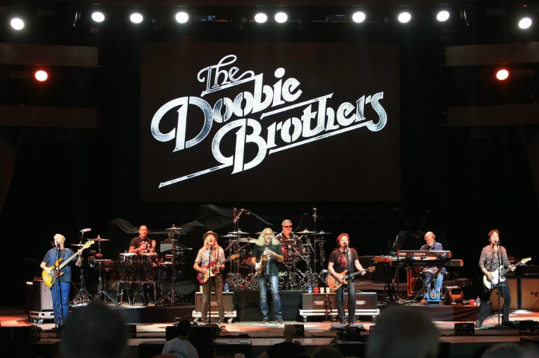 The Doobie Brothers perform at the 50th anniversary celebration of the Woodstock Festival at Bethel Woods Center for the Arts