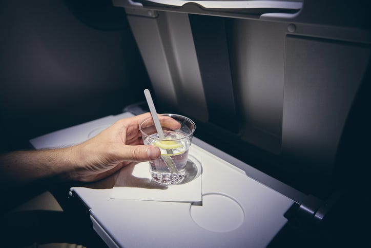 Drinking soda on a plane