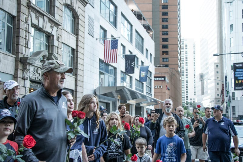 Frank Siller, the founder of the Tunnel to Towers Foundations, poses for photos in New York City after completing his 500-mile walk from the Pentagon to Lower Manhattan on the 20th anniversary of the 9/11 terror attacks Saturday, Sept. 11, 2021.