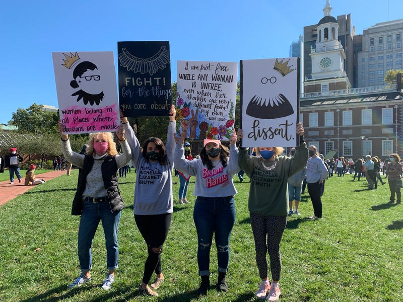 A group of women take part in Saturday's Women's March from Old City to the Benjamin Franklin Parkway.