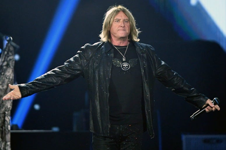 Joe Elliott of of Def Leppard performs onstage