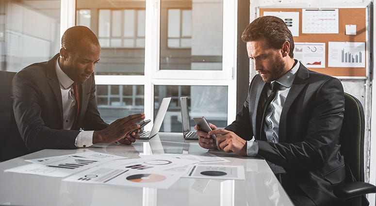 The Pros and Cons of Giving Your Employees Company Smartphones