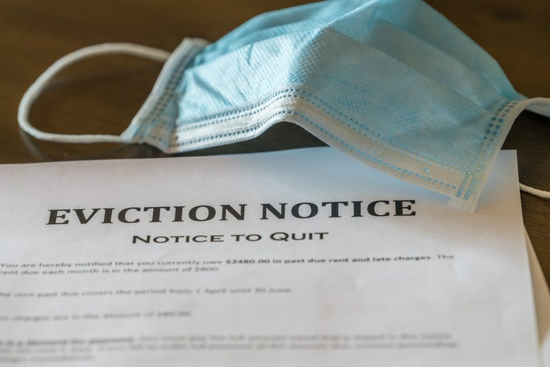 An eviction notice is served during the coronavirus pandemic