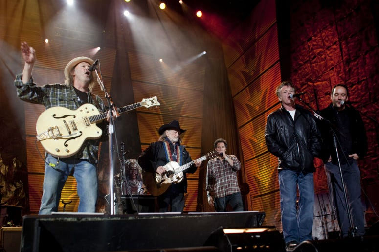 Neil Young, Willie Nelson, John Mellencamp and Dave Matthews perform on stage at Farm Aid 25