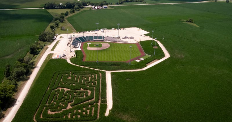 """A corn maze made to look like the MLB logo sits between a new stadium (pictured) built on the """"Field of Dreams"""" site and the iconic field carved into a cornfield."""