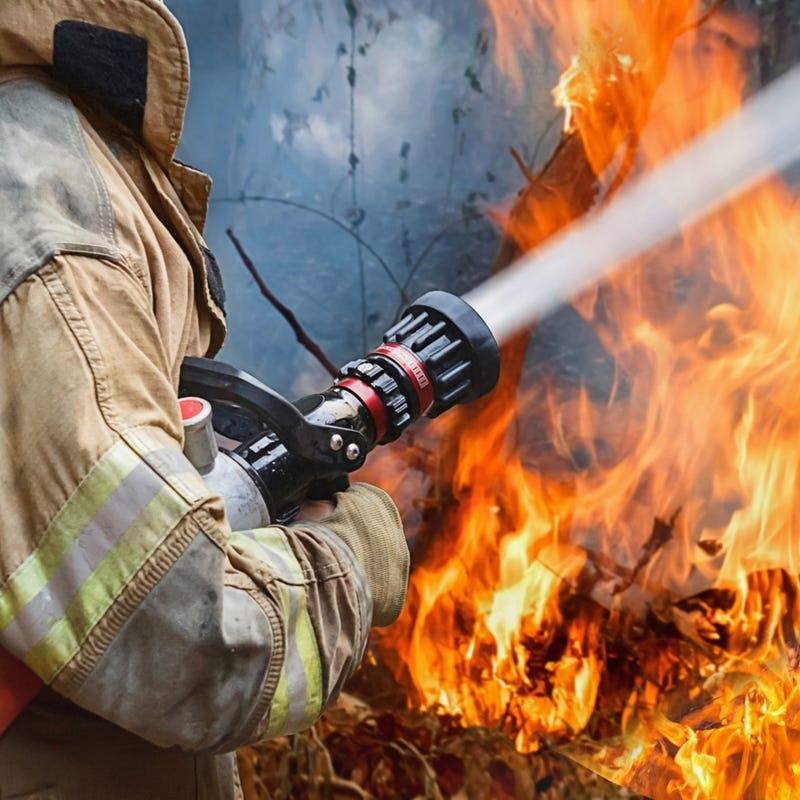 Firefighter battles wildfire