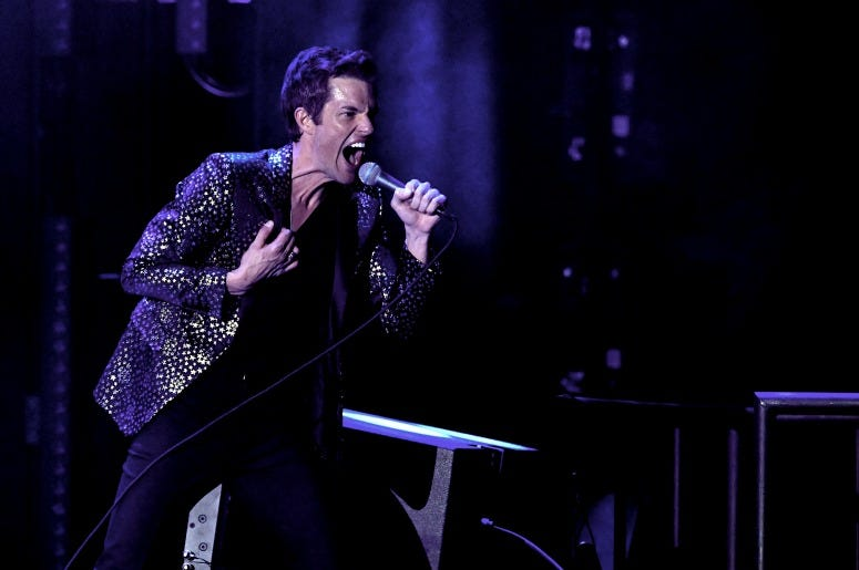 Brandon Flowers of The Killers performs on stage