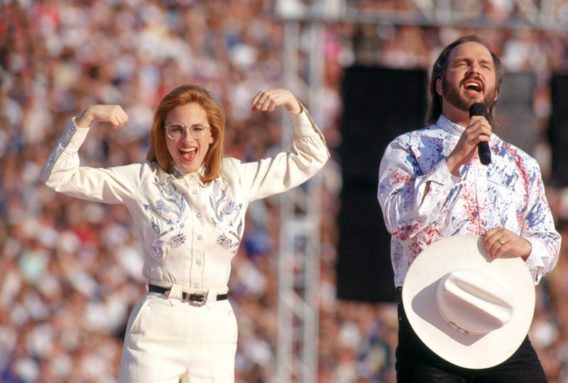 Country music star Garth Brooks sings the National Anthem with American sigh language translation preformed by actress Marlee Matlin prior to Super Bowl XXVII between the Dallas Cowboys and the Buffalo Bills at the Rose Bowl on January 31, 1993