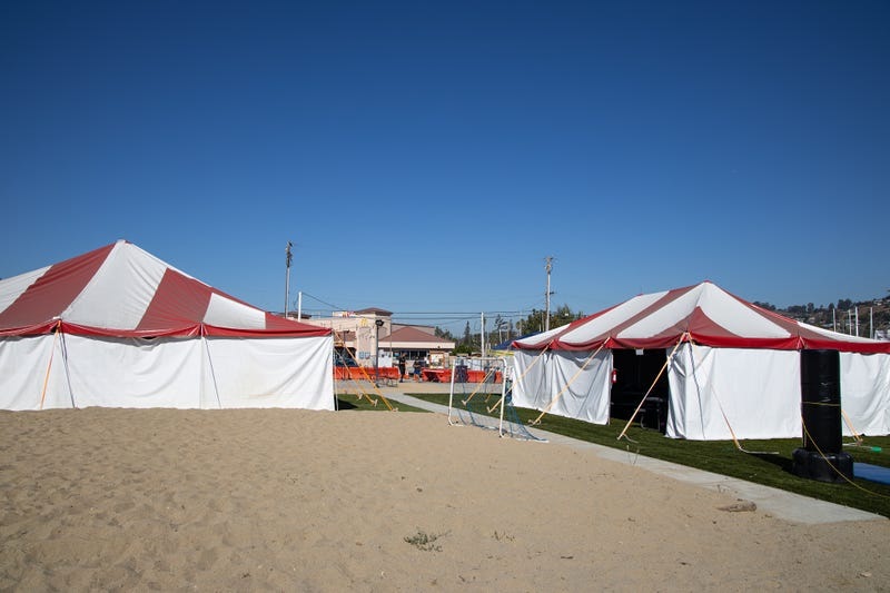 A pop-up education hub hosted by the Alameda County Sheriff's Department under red and white tents in San Leandro.