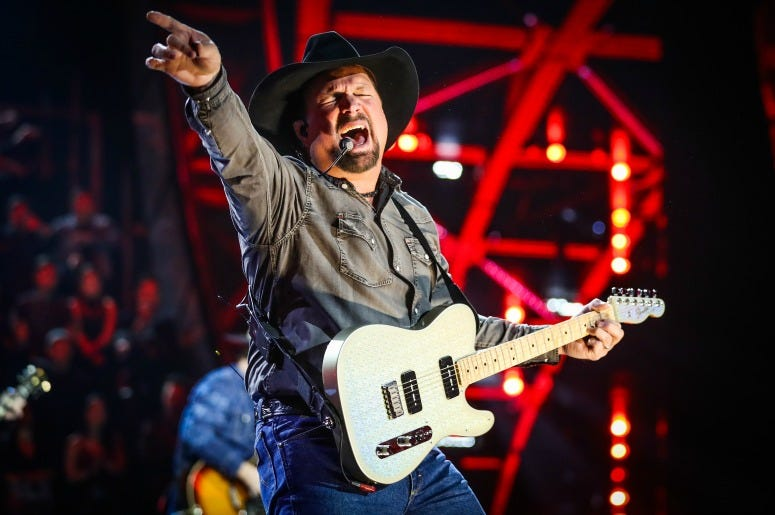 Garth Brooks performs on stage