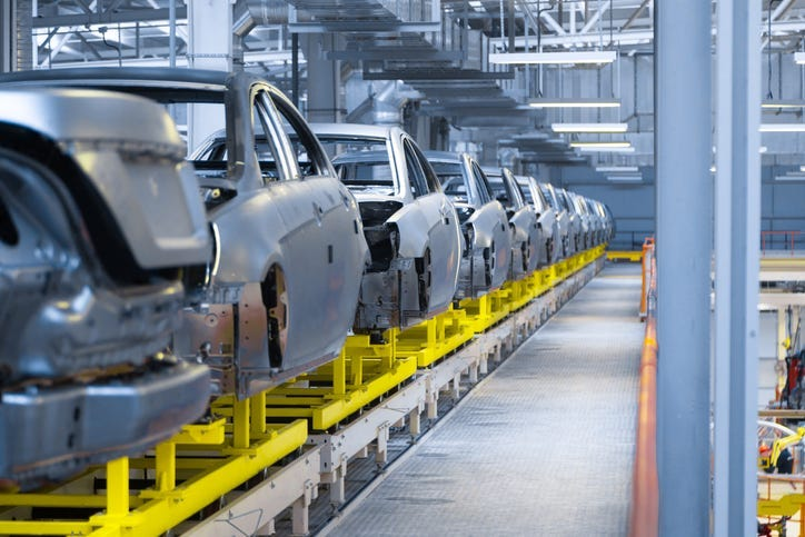 cars being assembled in factory