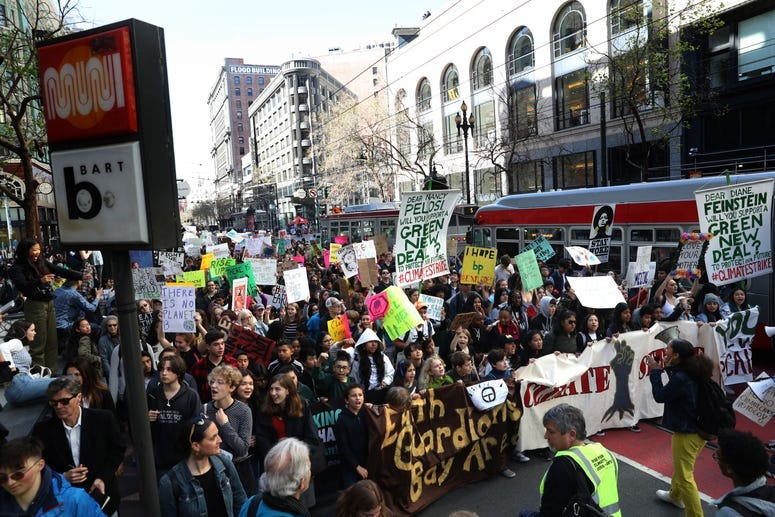 SAN FRANCISCO, CALIFORNIA - MARCH 15: Protesters carry signs as they march during the Youth Climate Strike on March 15, 2019 in San Francisco, California.
