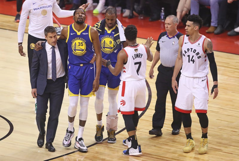 Kevin Durant limps off the court in Game 5 of the NBA Finals.