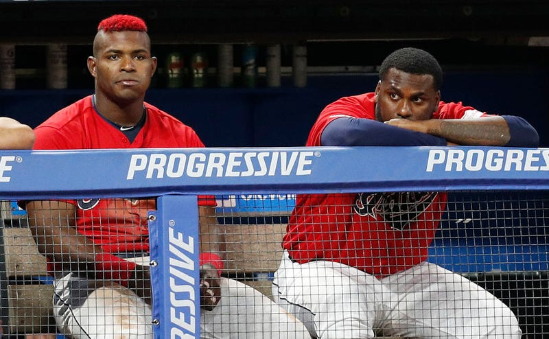 CLEVELAND, OH - AUGUST 01: Yasiel Puig #66 and Franmil Reyes #32 of the Cleveland Indians watch from the dugout in the eighth inning against the Houston Astros at Progressive Field on August 1, 2019 in Cleveland, Ohio. The Astros defeated the Indians 7-1.