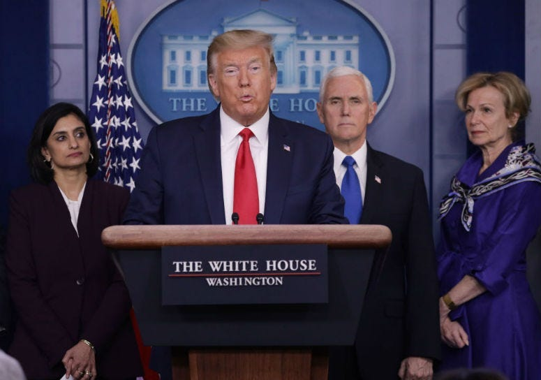 Flanked by members of the Coronavirus Task Force, U.S. President Donald Trump speaks during a news briefing on the latest development of the coronavirus outbreak.