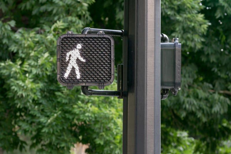 Pedestrian signal at crosswalk