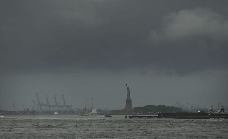 The Statue of Liberty stands in New York Harbor on a rainy and windy afternoon on July 25, 2018 in New York City.