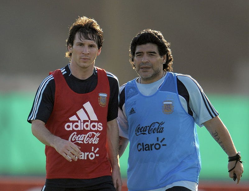 Argentina's football team coach Diego Maradona speaks with forward Lionel Messi (L) during a training session in Ezeiza, Buenos Aires on March 24, 2009.