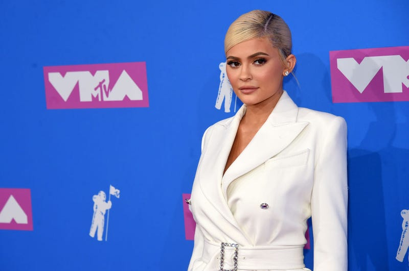 Kylie Jenner Rocks a Revealing Red Bow to Promote Holiday Makeup Line