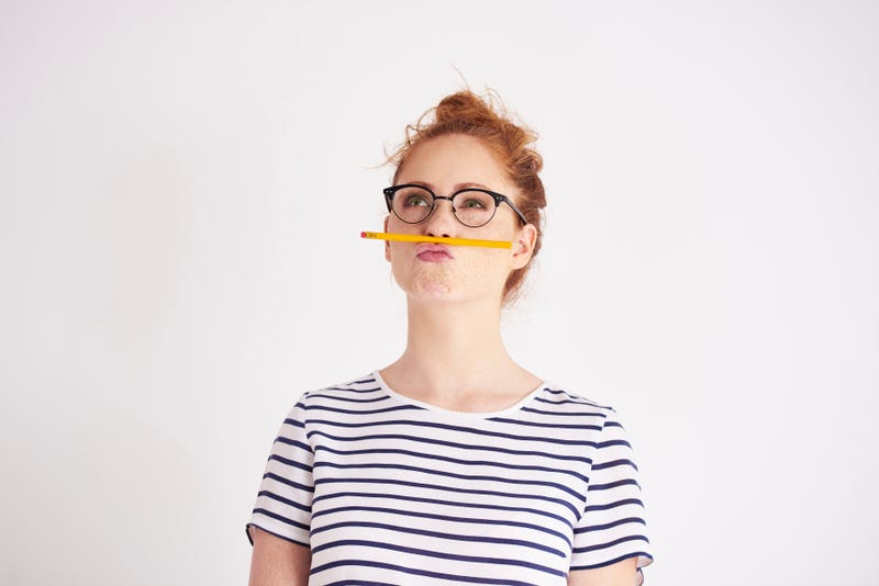 student balancing pencil on her lip