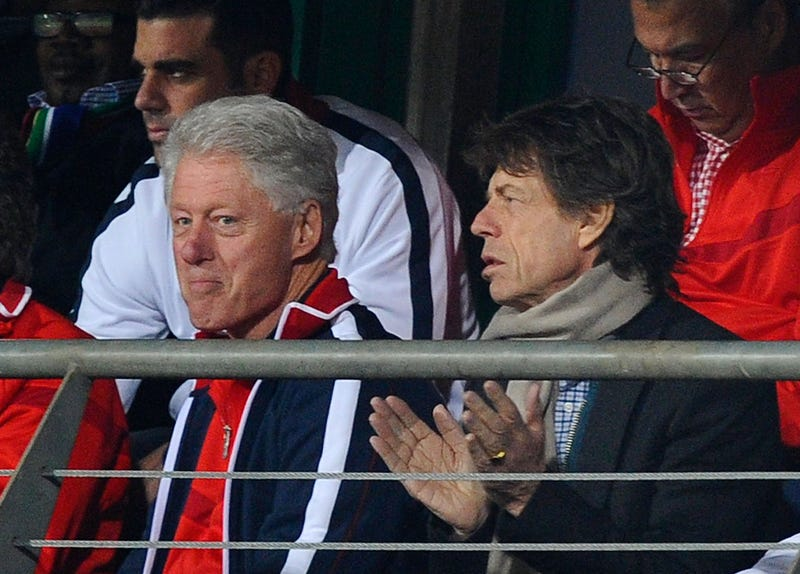 mick jagger and bill clinton watch world cup soccer