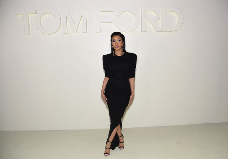 cardi b poses in a classic sleek black dress at the tom ford show on new york fashion week