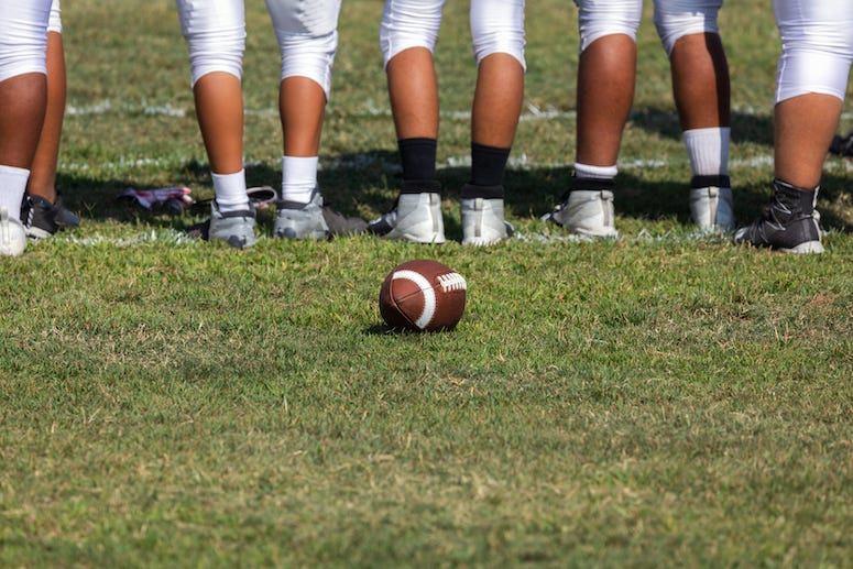 Football team lined up on field