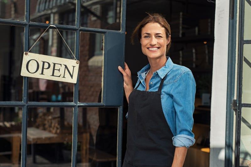 woman at door of business