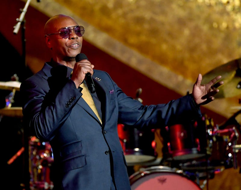 Dave Chappelle speaks onstage at Q85: A Musical Celebration for Quincy Jones at the Microsoft Theatre on September 25, 2018