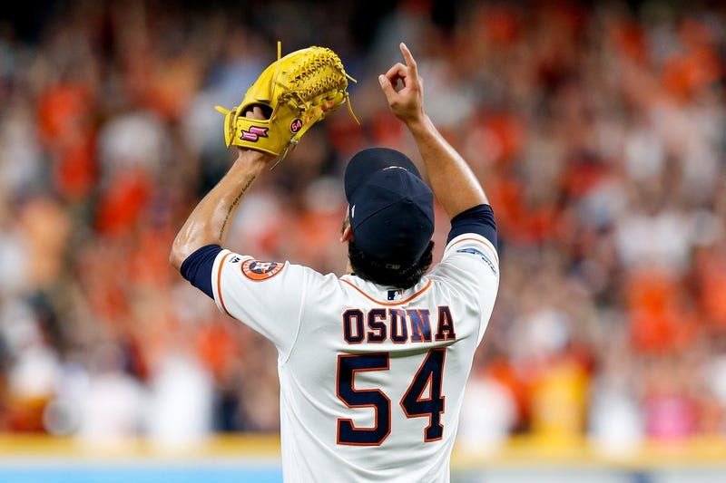 Roberto Osuna points to the sky after an Astros victory at Minute Maid Park