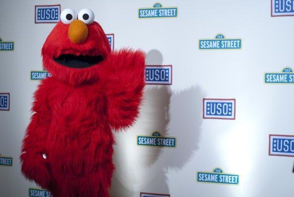 Elmo waves to the camera.