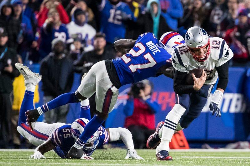 patriots quarterback tom brady is brought down by tre-davious white of the buffalo bills