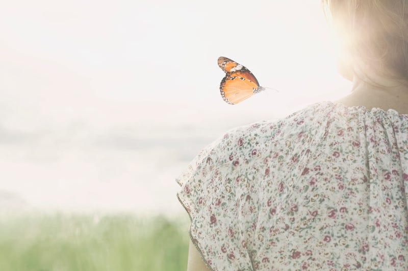 Butterfly over girl's shoulder