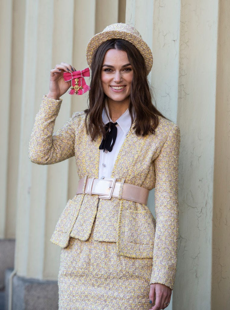Keira Knightley flaunts her Officer of the Order of the British Empire at Buckingham Palace in 2018