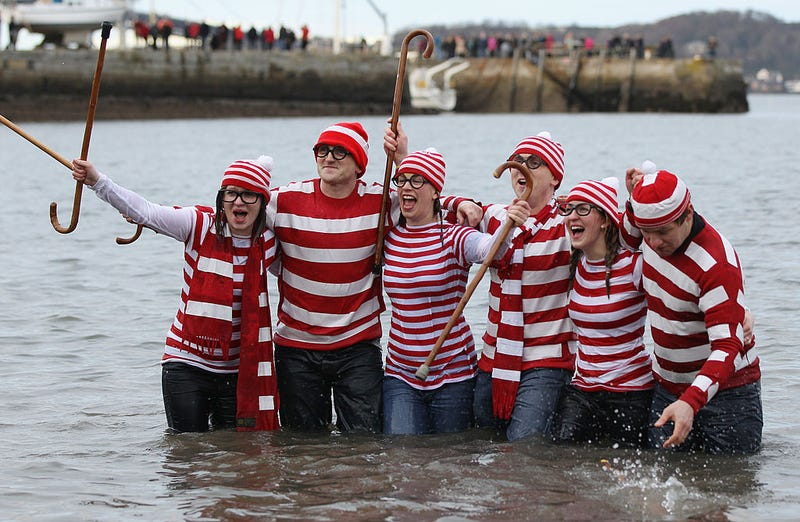 New Year revelers many in fancy dress, braved freezing conditions in the River Forth in front of the Forth Rail Bridge during the annual Loony Dook Swim on January 1, 2011 in South Queensferry, Scotland.
