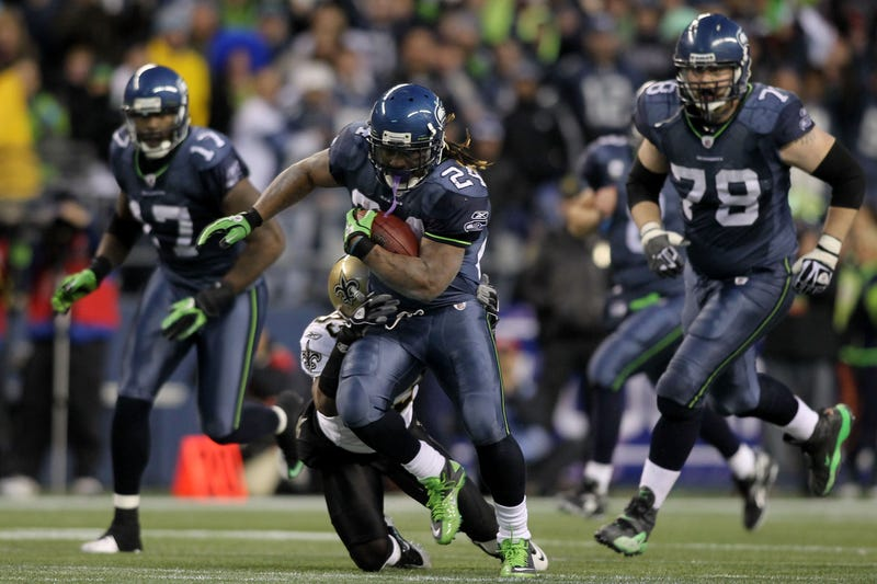 "Marshawn Lynch breaking free for his iconic ""Beast Quake"" run in 2011"
