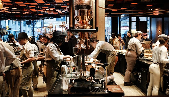 Employees serve customers at a Starbucks Reserve Roastery