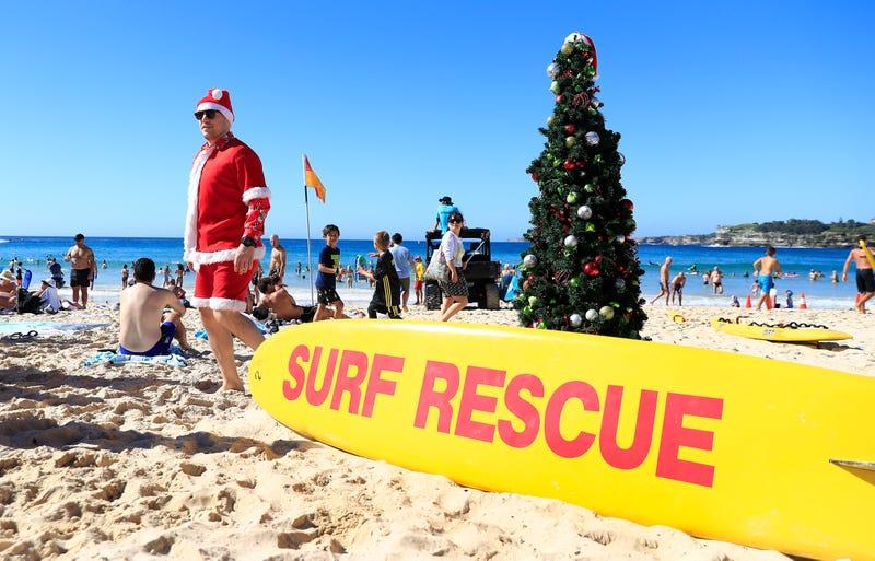 santa celebrates christmas on the beach