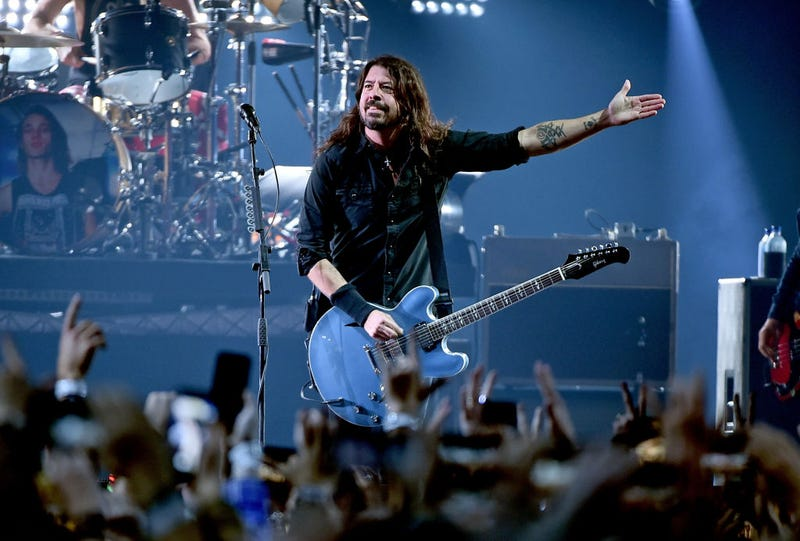dave grohl on stage with guitar