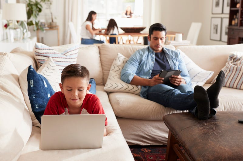 family on new electronic devices