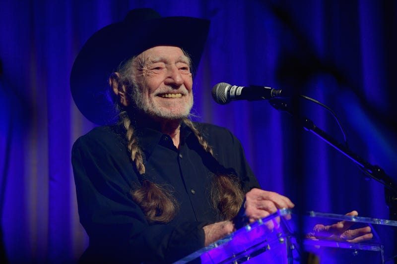 willie nelson speaks on stage at the 61st annual grammy awards