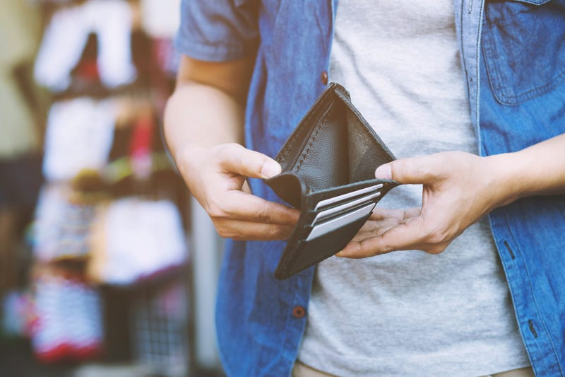 man opens wallet