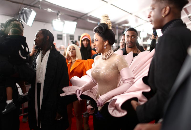 cardi laughing on the red carpet at the 61st annual grammy awards