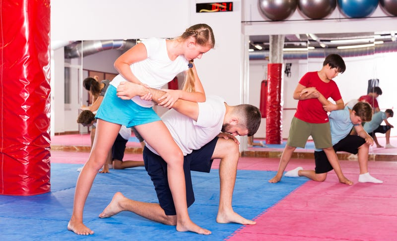 teen takes self defense course
